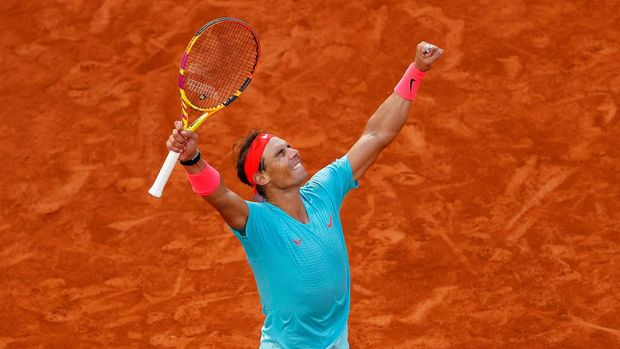 PARIS, FRANCE - OCTOBER 09: Rafael Nadal of Spain celebrates after winning match point during his Men's Singles semifinals match against Diego Schwartzman of Argentina on day thirteen of the 2020 French Open at Roland Garros on October 09, 2020 in Paris, France. (Photo by Clive Brunskill/Getty Images)